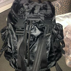 Kendall and Kylie black camouflage backpack.